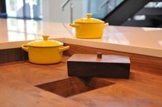 Contemporary Kitchen by Abby Smith Design. This hole in the chopping block leads to the trash. It enables the cook to scrape leftover bits directly into the bin when chopping. The top covers it up when not in use.