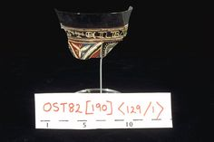 Beaker This is one of several glass fragments found in a chalk-lined cesspit in the goldsmiths' quarter of London. Altogether, at least eight vessels were found in the cesspit, all beakers for wine, decorated in coloured enamel. The designs include figures of saints, a pelican, and shields. On this example is an inscription around the rim: '...STERBA...', part of the maker's name, 'Master Bartholomew'.  Production Date: Medieval; 1290-1325