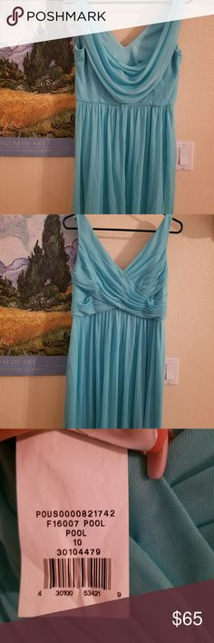 David's Bridal Bridesmaid Dress Pool Blue above the knee dress. F16007 size 10 cowl back.  Purchased this brand new and wore for a few hours. There are awesome small hooks that hold your bra strap in place. This dress is made very nicely. No alterations were done! David's Bridal Dresses Wedding