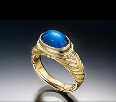 Google Image Result for http://ringoblog.com/wp-content/uploads/2010/05/blue-moonstone-ring.jpg
