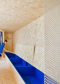 Architect Francesca Perani has transformed the porch of an Italian villa into a micro-apartment with plenty of hidden storage and an OSB engineered wood interior.