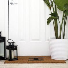 DIY this monogram doormat to greet your guests! (via Kristi Murphy)