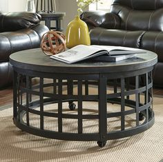 Gothic medieval round coffee table with open metal dark wrought iron finish cage base. Birch veneers round table top rivet details enhance the industrial vibe.