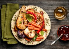 Roasted fruits and vegetables - Plate of roasted fruits and vegetables on wooden…