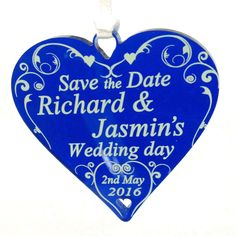 Save the date hearts, in blue with a swirl heart and cream or white text.   Perfect for announcing your wedding date and a great keepsakes for you guests.  Personalise with any name and date of your choice.  ** Includes Organza Gift Bags, Ribbon & Envelopes **