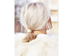 @Byrdie Beauty - A ponytail doesn't have to be boring! Try using a ponytail cuff around your hair elastic to dress it up.