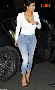 Simple at its Best...Kim Kardashian in white tee, frayed ankle length jeans and gold pumps