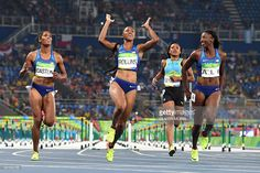 Gold medallist USA's Brianna Rollins (2ndL) celebrates as she crosses the finish…