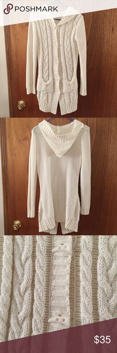 """White Hooded Long Cardigan Medium White hooded knit long cardigan, fits like a medium. Front pockets. Measures 33"""" from shoulder to hem. Like New, lightly worn. Sweaters Cardigans"""