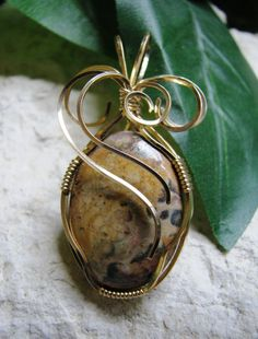 This pendant is made from a stone called Leopard Skin Jasper, which is a really nice gold-ish tan stone with subtle black and brown spots. The 14K