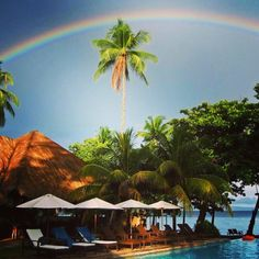 Who minds rain, when the result is a beautiful scene like this #philippines #rainbow #happy #travel #luxury