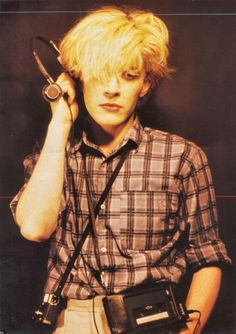 David Sylvian of the band Japan. Listening to music.
