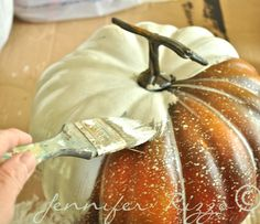 paint a fake pumpkin to make it look real
