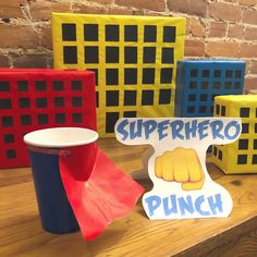 Custom decor for a superhero themed birthday party! Punch served in superhero cups with little Superman capes!