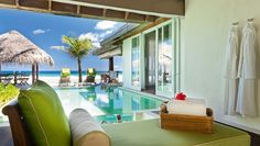 Naladhu Maldives: In Ocean Houses, alfresco bathrooms blend into private pools and the Indian Ocean beyond.