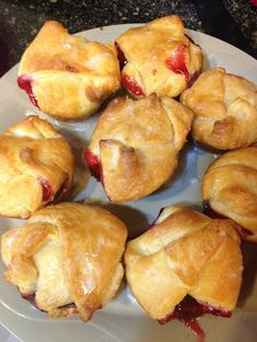 Mini Cherry Pie-Turnovers SO Super Easy to Make and Taste So Good! Fast Weekend or Weeknight Dessert or snack!  Made with crescent rolls!  http://iluvrecipes.blogspot.com/2013/08/mini-cherry-pies-delicious-and-easy-to.html       #cherrypie #Recipes  #dessert