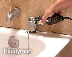 Photo 1 shows how to remove old caulk when you recaulk a shower.