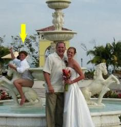 April Fools: The 10 Best Photobombs: Bride Bomb A woman riding a statue behind a married couple