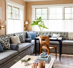 In Good Taste: Sara Gilbane - Design Chic - great tufted sofa in the living room - love how they put the desk for an instant office!