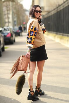 Eva Chen brought high-impact accessories to her black-and-tan outfit. #streetstyle at Paris Fashion Week Fall 2014 #PFW