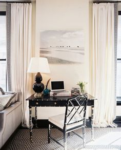 Chic black desk and chair, graphic black and white rug.