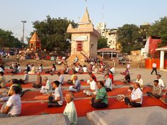 Saluting the sun, morning yoga on the shore of the river Ganges