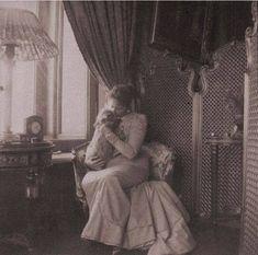 Empress Alexandra holding her little dog Eira (1900)