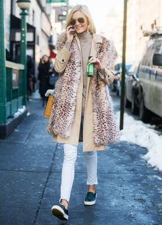 Layer a furry vest over your trench coat and turtleneck.