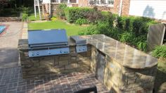 Outdoor kitchen/grilling station by Stratton Exteriors