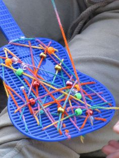 Irresistible Ideas for play based learning » Blog Archive » a genuine-blue-Nashville-fly-swatter-guitar!  Beads and any novelty fly swatter.
