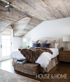 In the principal bedroom, Johnston lightened the mood by whitewashing the new wood planks on the angled ceiling. | Photo: Donna Griffith Design: Ann Johnston Design Consultants and Ray Murakami