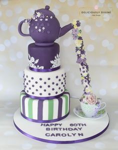 A teapot with during flowers 3 tier birthday cake. Purple and green suffragette colours, with cake lace, small roses and stripe tiers. cascading flowers with highlights of yellow and green also added. A great 40th, 50th, 60th, 70th, 80th birthday cake or a show stopping wedding cake. An ideal cake for any girls, birthday, be it mum, grandma, auntie, sister or daughter, young or old. To enquire or book email: lee-anne@deliciou...