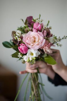 A hand-tied posy with a 'just-picked' look, in the prettiest shades of pinks - the perfect bouquet for a bride on a budget!