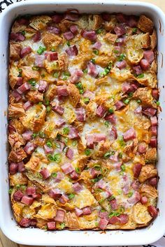 Ham and Cheese Croissant Breakfast Casserole - delicious and easy brunch bake! Soft on the inside and slightly crunchy on the outside, this casserole combines croissants, ham, and cheese. Comfort food for the holidays. #casserole #brunch #breakfast #ham #cheese #comfortfood #holiday #recipe #joyousapron