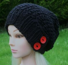 Knitted with 100% soft, chunky acrylic yarn, i used soft black yarn and red wooden buttons to make this beautiful hat. It is warm and soft, to fit