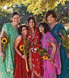 Bridesmaids wearing traditional Indian saris with sunflower bouquets, photo by J. Cogliandro Photography