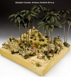 """Desert Oasis : Afrkia Korps Style"" Here is the first of several ""look-sees"" at a little diorama Gordon completed this past weekend. As you can see it is a ""Desert Oasis"" somewhere in North Africa during 1941/42. The ""Desert Fox"" himself is taking the time to stretch his legs while his escort are replenishing their water supplies. While at the oasis they have picked up a British straggler along the way."