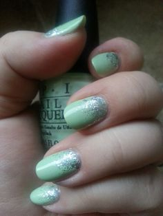 Round nail, mint green nail polish with silver gradient glitter. Polishes used: Orly Binder Base Coat, Orly Polishield Top Coat, O.P.I. Gargantuan Green Grape, Orly Tiara (micro glitter) and Pure Ice Dazzle Me (larger/holo glitter)