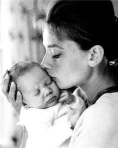 Audrey Hepburn kissing her baby