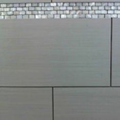 Silkstone_Marfil_12x24  For $2.99 a foot that kind of floor tile mixed with a really cool accent like the shiny white one here, maybe in the bright blue or something?