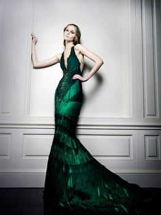 Celia Kritharioti. I'm not a huge fan of the bodice but I ADORE the shape, the color, and the skirt!