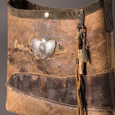 Chaps leather mini bucket with beautiful hand wrought sterling silver bird concho by @hozho_naturalproducts Japan.  A great pairing