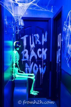 Writing glow in the dark Halloween messages on your walls is really easy with this DIY trick...and it will wash right off afterwards with a little water.