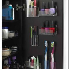 Organize your bath essentials in the door. I'm so doing this for the kids bathrooms.