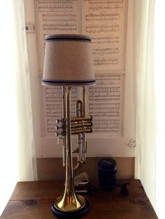 Repurposed trumpet table lamp with a black wood base with a beige linen with black trim lampshade by MusicAsArtBySarah on Etsy