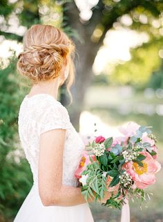 A braided updo only enhances this bride's lacey, high neck look.