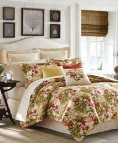 The Daintree Tropic Comforter Set from Tommy Bahama Home is crafted from 230-thread count cotton sateen and features a tropical, leafy green pattern print mixed with coral, gold and white orchids on a
