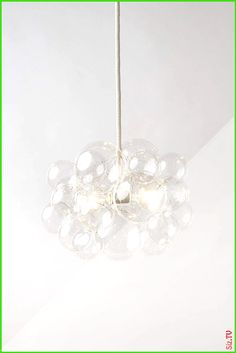 The 25 Bubble Chandelier The 25 Bubble Chandelier rachelle Home Decor Hand blown glass bubbles are individually arranged to create a shape reminiscent nbsp hellip Bubble Chandelier, Outdoor Chandelier, Hand Blown Glass, Bubbles, Ceiling Lights, Shapes, Create, Home Decor, Ceiling Lamps