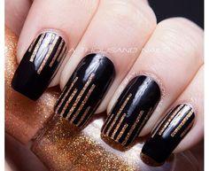 Gold glitter and black striping tape mani