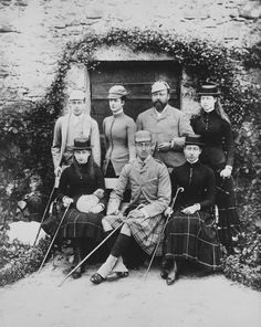 Prince George; Alexandra, Princess of Wales; the Prince of Wales; Princess Victoria of Wales. Seated: Princess Maud, with small dog on her lap; Prince Albert Victor; Princess Louise. Highland dress.